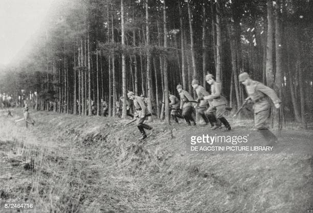 German soldiers coming out of a forest to attack an enemy position in the Vosges France World War I photo by Argus from L'Illustrazione Italiana Year...