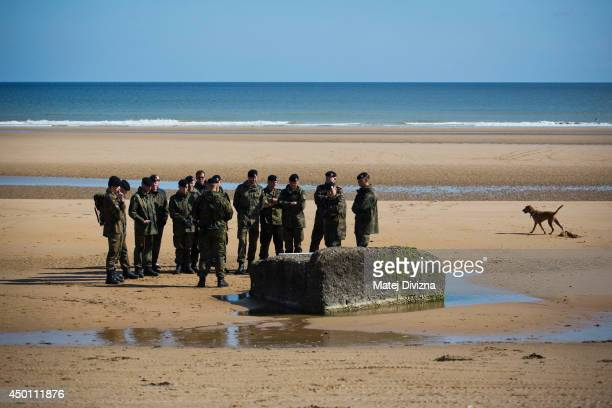 German soldiers debate in the Omaha Beach June 5 2014 near CollevillesurMer France Friday 6th June is the 70th anniversary of the DDay landings which...