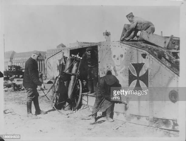 German soldiers destroying their tanks and heavy artillery following World War One and the signing of the Peace Treaty Germany circa 1919
