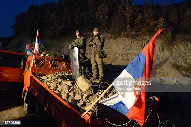 German soldiers from NATO-led KFOR on top of a barricade built by Serbs protesting in northern Kosovo.