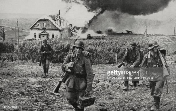 German soldiers in a destroyed village Ukraine World War II from L'Illustrazione Italiana Year LXIX No 23 June 7 1942