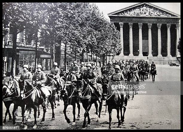 German soldiers marching through Paris, France infront sainte madeleine. Dated 1940 during the occupation of France.