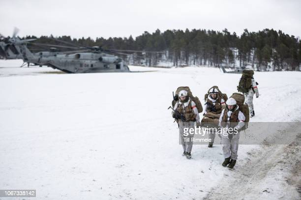 German soldiers of the 232nd Mountain Infantry Battalion with Norwegian medic support board a U.S. Marine Corps CH-53E Super Stallion helicopter...