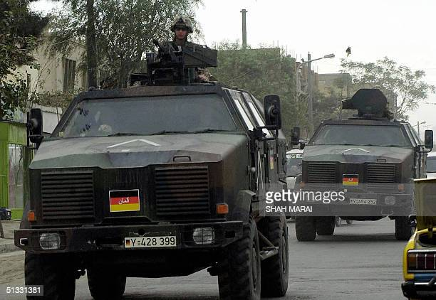 German soldiers of the International Security Assistance Force patrol the streets of Kabul, 21 September 2004. Within one week both Afghan President...