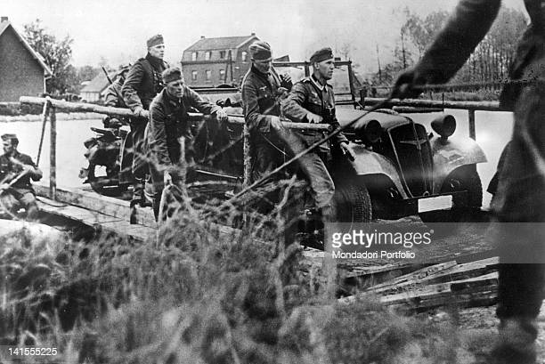 German soldiers on motor veicles cross the River Meuse heading for Belgium Maastricht 11 May 1940