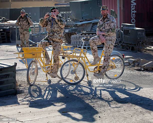 German soldiers on old delivery bicycles in the army camp of the Bundeswehr in Afghanistan on December 13 in MazareSharif Afghanistan