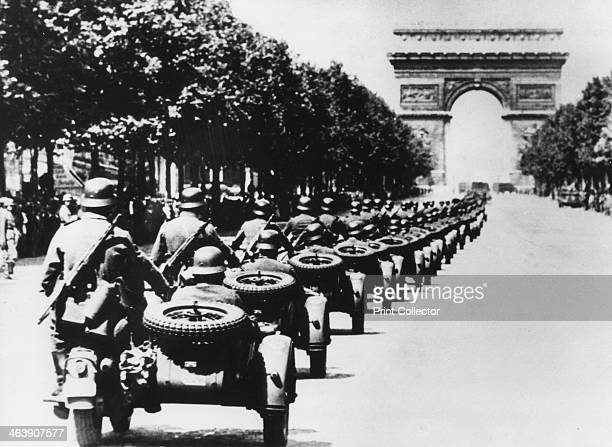 German soldiers on the Champs Elysees Paris 14 June 1940 A column of German troops in motorcycles with sidecars heading towards the Arc de Triomphe...