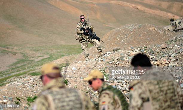 German soldiers patrol as they secure the area for a visiting military commander near Baghlan on March 27 2012 Some 500 German Soldiers are stationed...
