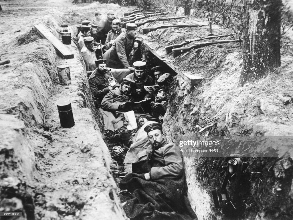 German soldiers read newspapers in their trench during a lull in the fighting at the Fourth Battle of Ypres, October 1918.