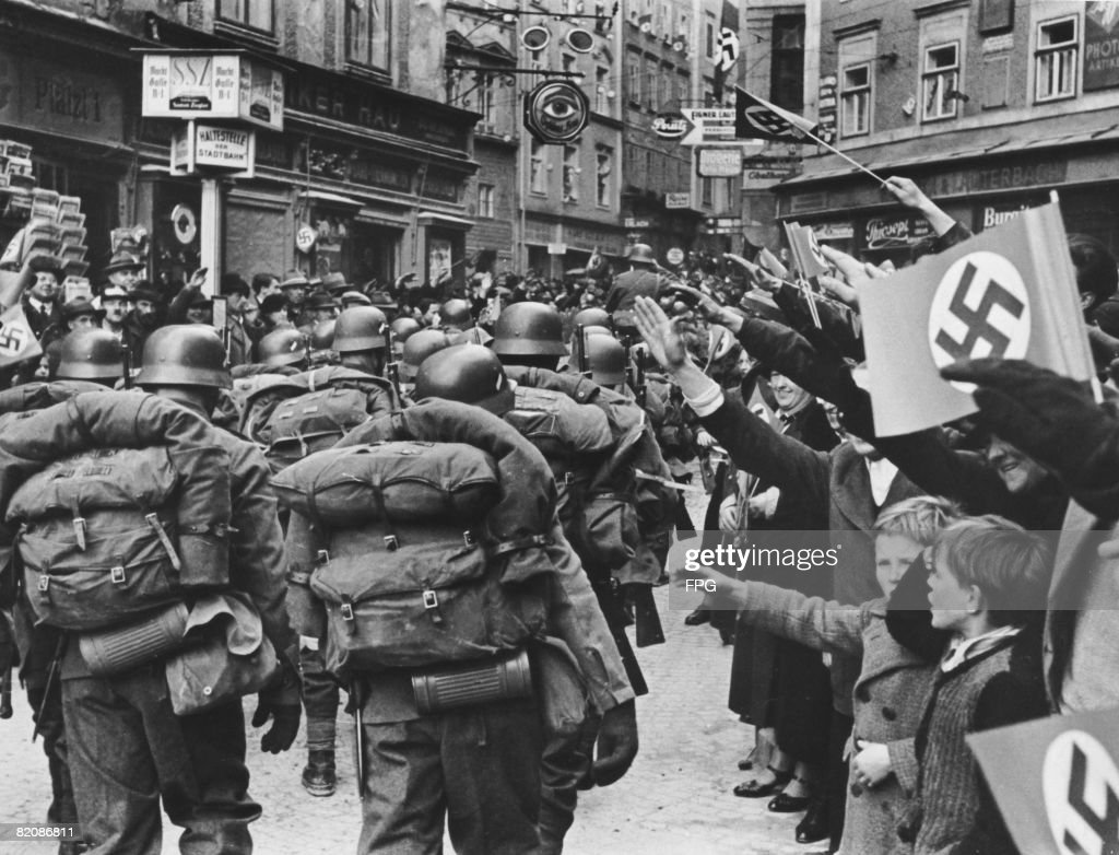 German soldiers receive a hearty welcome upon their arrival in Salzburg during the Anschluss, March 1938.