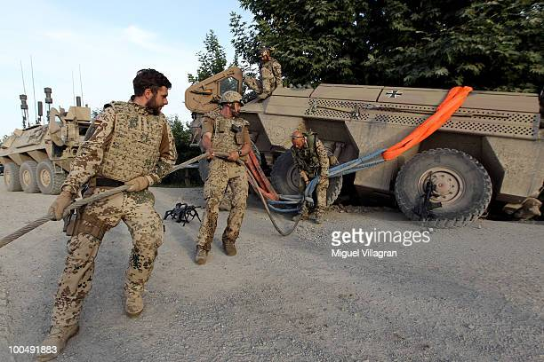 German soldiers recover an amoured vehicle that accidentally went off the road on May 25 2010 in Chahar Darreh Afghanistan Germany has more than 4500...