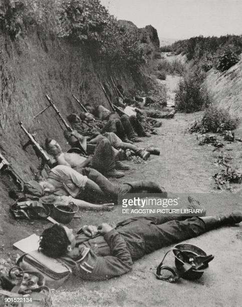 German soldiers resting in a ditch on the Russian front World War II from L'Illustrazione Italiana Year LXIX No 32 August 9 1942