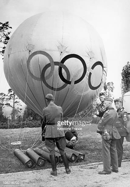 German Soldiers Sending Off A Captive Balloon Marked With The Emblem Of The Olympic Games Then Taking Place In Berlin From August 1St To The 16Th...