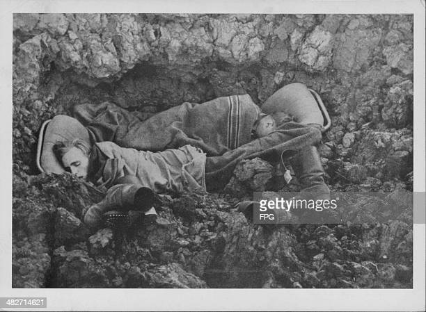 German soldiers sleeping in a bomb crater on the front lines during World War Two Russia circa 19411945