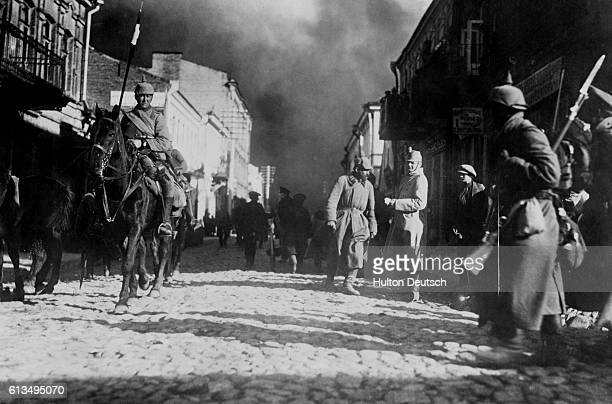 German soldiers stand in a burning street after occupying the town of Szawle ca 1915 | Location Szawle USSR
