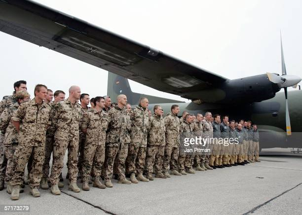 German soldiers stand in front of a Transall C160 military plane after their return from a mission in Sudan Africa on March 24 2006 at the airbase in...