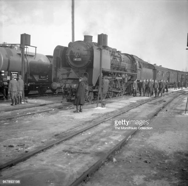 German soldiers standing beside a large steam locomotive Germany circa 1940