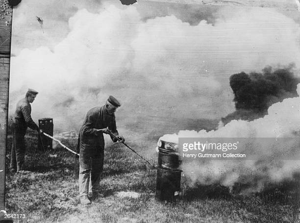 German soldiers taking advantage of a suitable wind to emit poison gas from cylinders