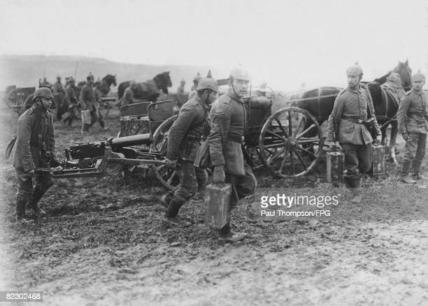 German soldiers transport machine guns to the trenches in the Aisne region of northern France during World War I circa 1918