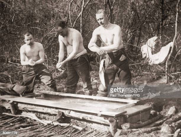 German soldiers wash themselves in a trough in the Forest of Argonne during World War I circa 1917