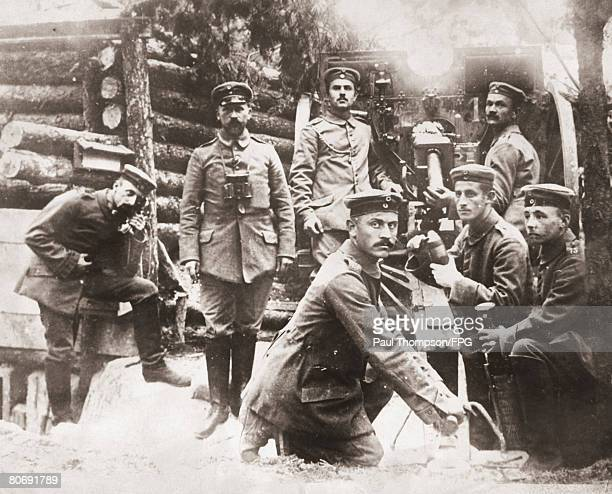 German soldiers with a field gun during World War I circa 1917 This photograph was found on the corpse of a German soldier and the gun itself was...