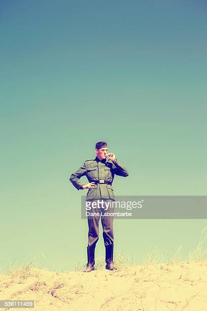 WWII German Solider Smoking On Top Of A Desert Hill