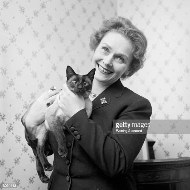 German soprano Dame Elisabeth Schwarzkopf holding a cat