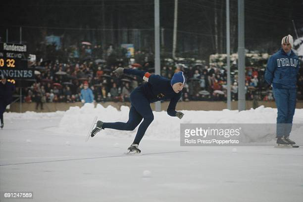 German speed skater Erhard Keller pictured in competition in the 1969 European Speed Skating Championships event on an ice covered long track in...