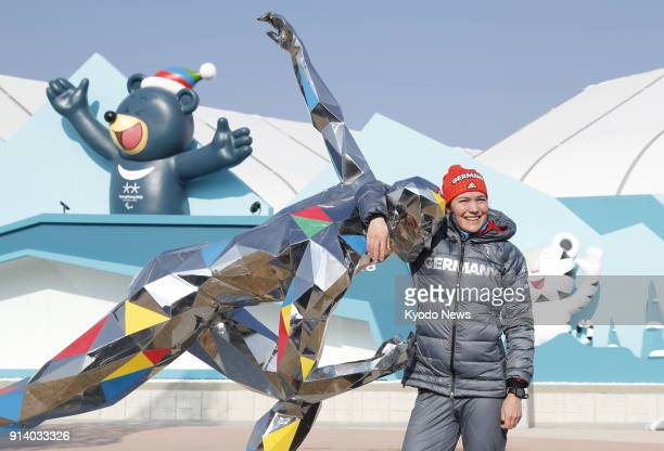 German speed skater Gabriele Hirschbichler poses with a statue at Olympic Park in Gangneung on Feb 3 ahead of the Pyeongchang Winter Olympics ==Kyodo