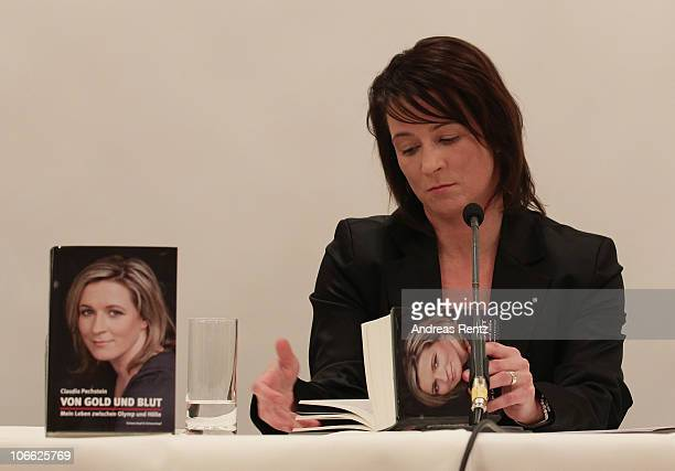 German speed skating champion Claudia Pechstein reads in her autobiography 'Of gold and blood my life between Olympus and hell' during her book...
