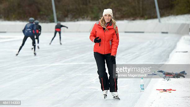 German speedskater Anni Friesinger signs a autograph to a girl before the 'Real Cool Runnings' Photocall on December 7 2013 in Munich Germany
