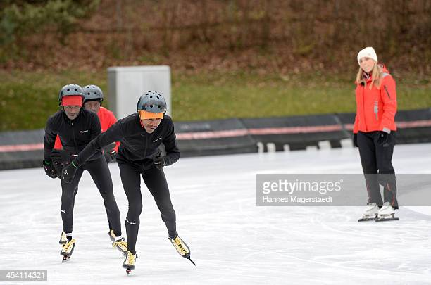 German speedskater Anni Friesinger watch the marathon runners before the 'Real Cool Runnings' Photocall on December 7 2013 in Munich Germany