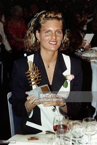 German sprinter Katrin Krabbe double World champion at the Tokyo Olympics poses on November 21 1991 with his trophy of female athlete of the year at...