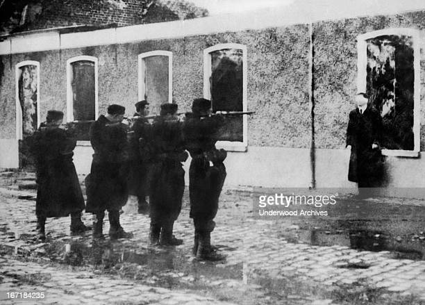 A German spy caught near Termondo is blindfolded and executed at dawn by the firing squad Termondo Belgium October 5 1914