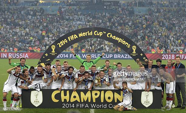 German squad pose after winning the 2014 FIFA World Cup final football match between Germany and Argentina at the Maracana Stadium in Rio de Janeiro...