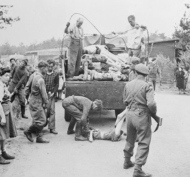 German Schutzstaffel Men Loading Bodies Onto Truck