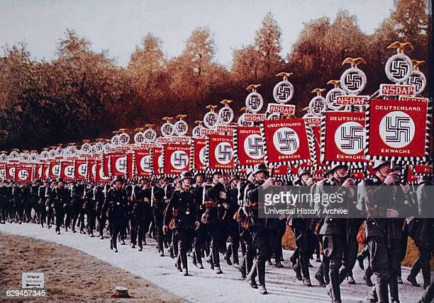 German SS Troops Bearing Standards March in Zeppelin Field Nurnberg Germany 1933