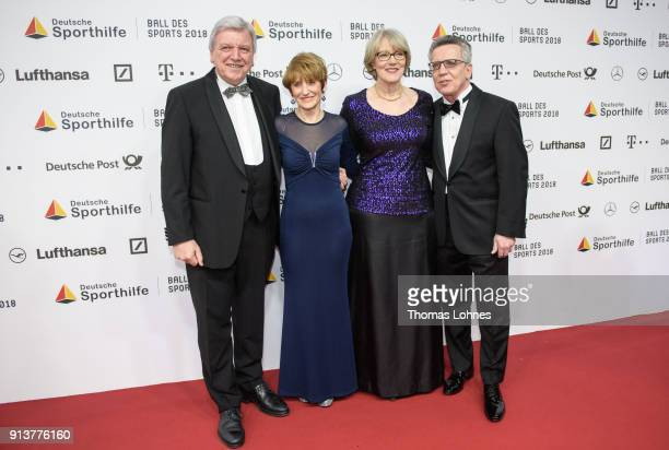 German State Premier for the state of Hesse, Volker Bouffier, his wife Ursula, Interior Minister Thomas de Maiziere and his wife Martina attend the...