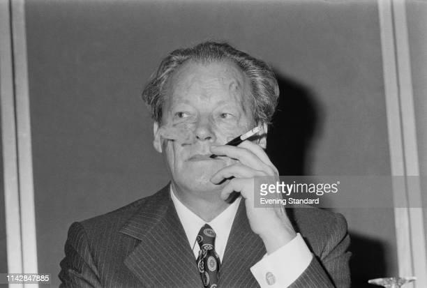 German statesman Willy Brandt leader of the Social Democratic Party of Germany and Chancellor of the Federal Republic of Germany smoking a cigarette...