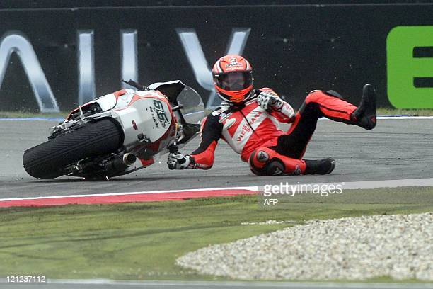 German Stefan Bradle crashes in Moto2 class on June 25 2011 in Assen during the Dutch Grand Prix AFP PHOTO/ANP / VINCENT JANNINK netherlands out...