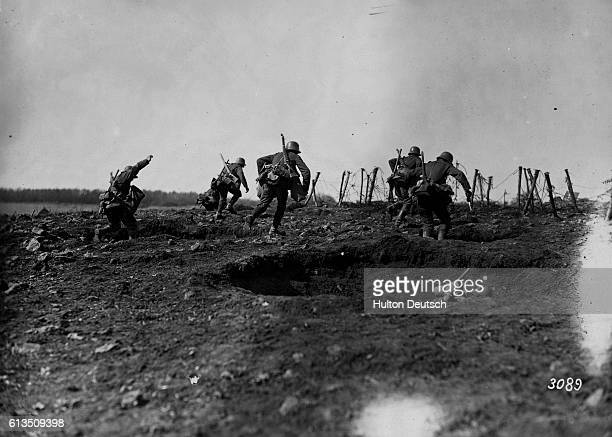 German storm troops laden with equipment have to advance over open but broken ground The enemy know of their approach because of a preliminary barrage