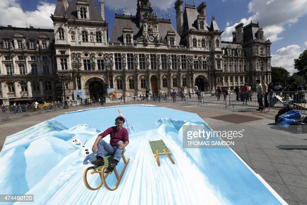 German street artist Edgar Mueller poses on his trompe l'oeil fresco painted in front of the Paris City hall as part of a communication operation for...