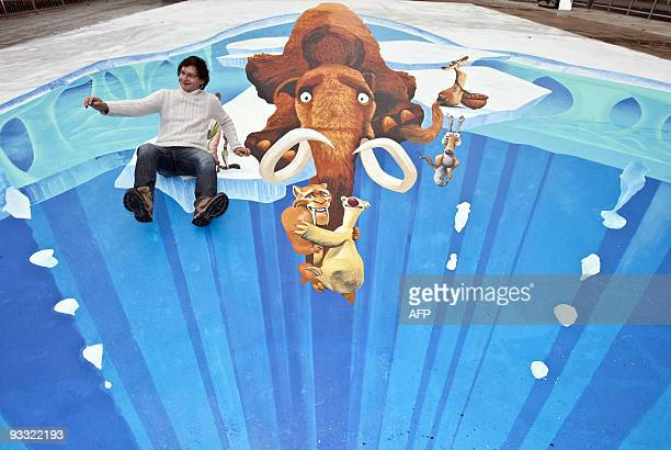 German street painter Edgar Muller poses for photographers on his 320 square metre Guinness world record breaking 3D pavement art scene from the...