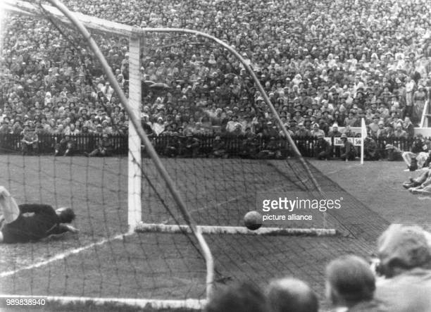 German striker Helmut Rahn beats Hungarian goalkeeper Gyula Grosics from a 17 meter distance in the 85th minute during the 1954 FIFA World Cup final...