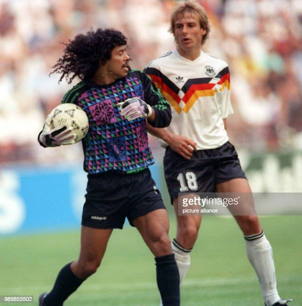 German striker Juergen Klinsmann and Colombian goalkeeper Rene Higuita who holds on to the ball provocatively long The match ends with a 11 tie in...