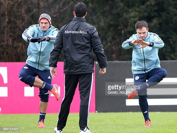 German striker Mario Gomez and Germany's defender Heiko Westermann attend a training session of the German national football team prior to the World...
