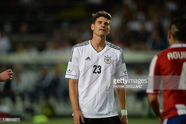 German striker Mario Gomez reacts during the friendly football match Germany vs Paraguay in preparation for the FIFA World Cup 2014 on August 14 2013...