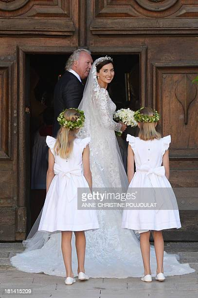 German student Claire Lademacher accompagnied by her father Hartmut smile before the religious wedding ceremony with Prince Felix of Luxembourg on...