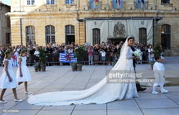 German student Claire Lademacher arrives for her wedding ceremony with the Prince of Luxembourg on September 21 2013 at the Saint Mary Magdalene...