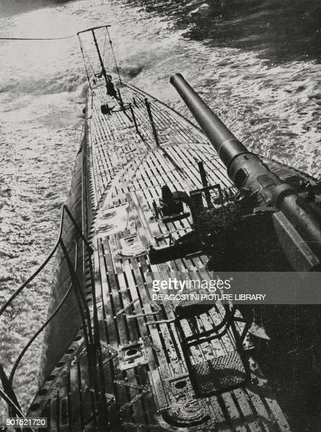 German submarine emerging to fire on an enemy merchant ship in the Atlantic Ocean, World War II, from L'Illustrazione Italiana, Year LXIX, No 12,...